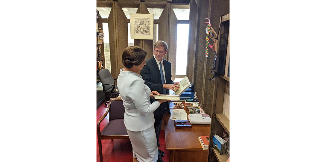 Giedrius Subačius & Diana Nausėdienė look at his book